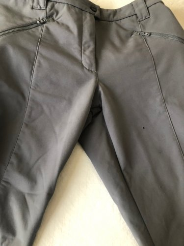 A campfire spark left a hole in these soft-shell pants.