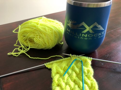 Knitting a running headband to make a focused use of my couch time.